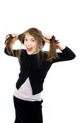 Emotional girl pulling her hair over white background