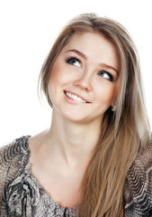 Portrait of a smiling thinking woman looking up