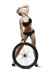 Young, beautiful woman with bicycle wheel