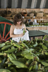 Woman shopping for corn at the farmers market