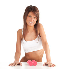 exercising young woman in lingerie with pink fitness weights