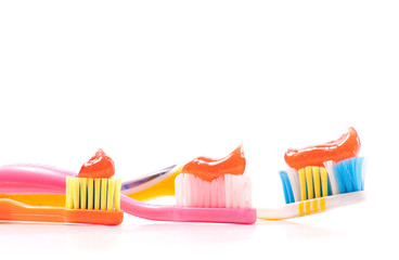 Three Tooth Brushes with Tooth Paste