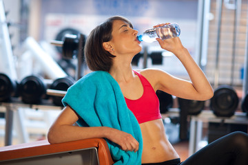 woman in gym drink water
