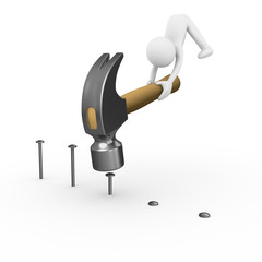 Man crushing nails with a big construction hammer