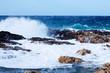 Sea wave breaking against coast  rock