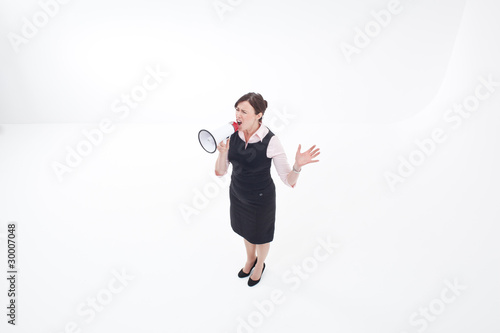 Businesswoman shouting into megaphone