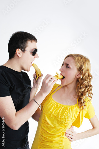 Funny love couple with bananas