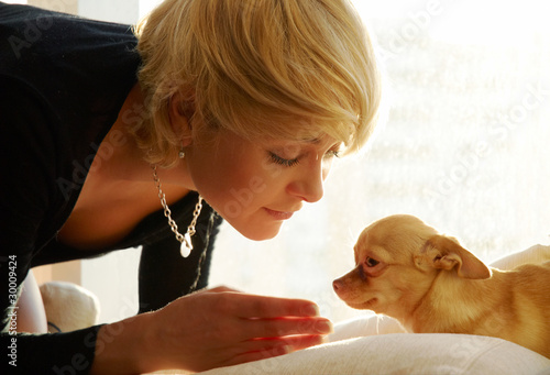 girl and chihuahua in sun light