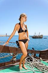 Girl and sailing ship.