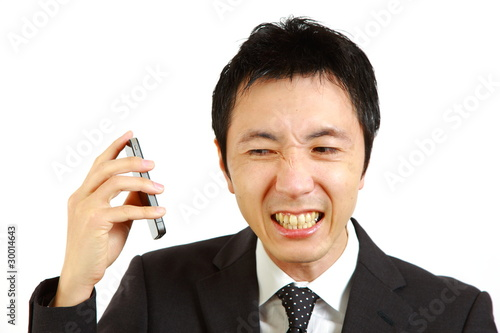 Business man being shouted at on the phone