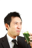 japanese businessman drinks green vegetable juice
