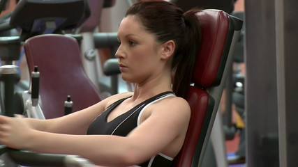 Attractive dark-haired woman doing exercise