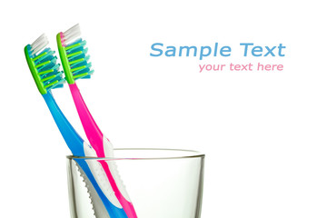 two toothbrushes in the glass with copy-space