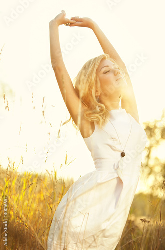 Young woman on summer field portrait
