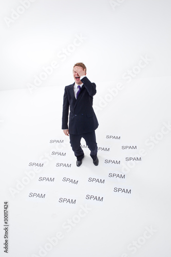 Businessman surrounded by spam