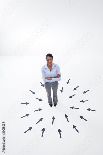 Businesswoman surrounded by arrows