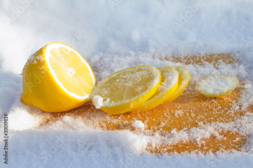 The cooled lemon among ice close up