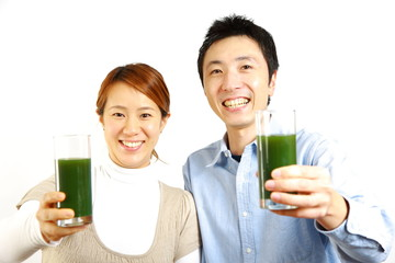 couple drinks green vegetable juice