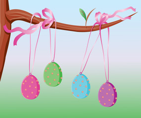 easter eggs tied with a shiny pink ribbon