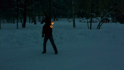 Fire show - tricks with burning poi