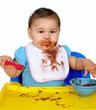 baby with messy chocolate pudding face