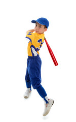 Young child swinging a baseball bat