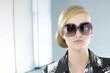 fashion model in sunglasses in the studio