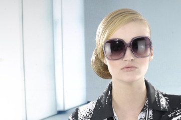fashion model in sunglasses in the studio