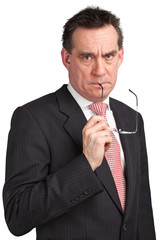 Frowning Angry Businessman Holding Glasses