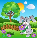 Louka s zajíček drží květiny