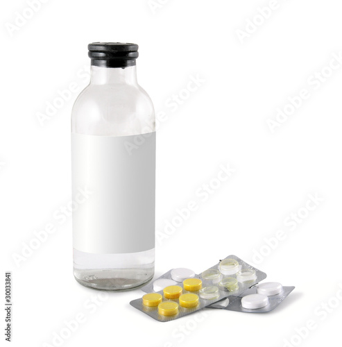 Medical glass bottle and packing tablets isolated on white