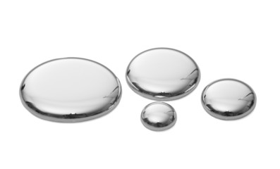 Droplets of mercury isolated on white.