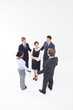 Four businesspeople circling businesswoman