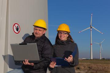 Two Engineers in Wind Turbine Power Generator Station