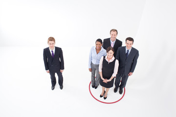 Businesspeople standing inside and outside hoop