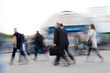 Motion blurred image of people rushing to work