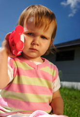 Young girl child outdoor with toy phone