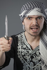 angry arabic man with knife