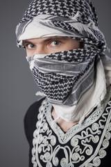 arabic man in headscarf