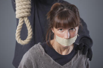 woman and hangman with noose