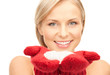beautiful woman in red mittens with snow