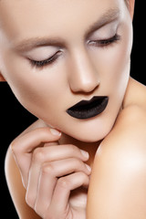 Beautiful fashion model with black lips make-up, perfect skin