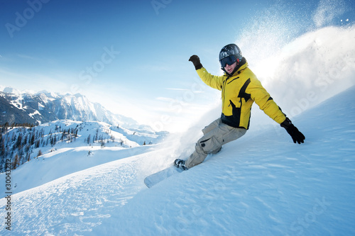 Freeride snowboarding photo in deep powder