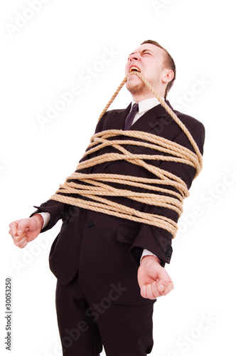The young businessman connected by a rope shouts