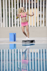 woman fitness exercise at poolside