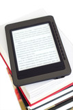 Ebook reader on pile of ordinary books poster