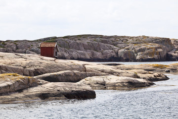 Wood shed on the rocks