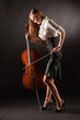 Elegant girl playing with passion on bass-viol