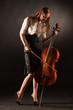 Elegant girl playing on violoncello