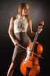 Elegant girl playing on bass-viol